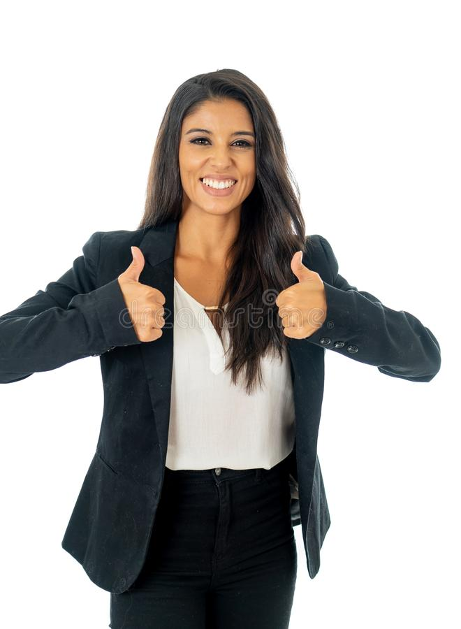 Full length portrait of Attractive latin corporate latin woman looking excited and making thumb up sign in Creative success and royalty free stock image