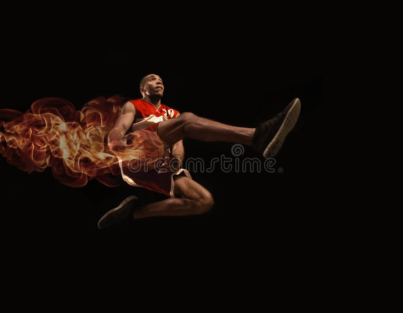 Full length portrait of a basketball player with ball royalty free stock photography