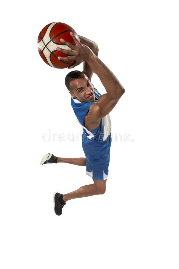 Full length portrait of a basketball player with ball. Full length portrait of a basketball player with a ball isolated on white studio background. advertising stock photos