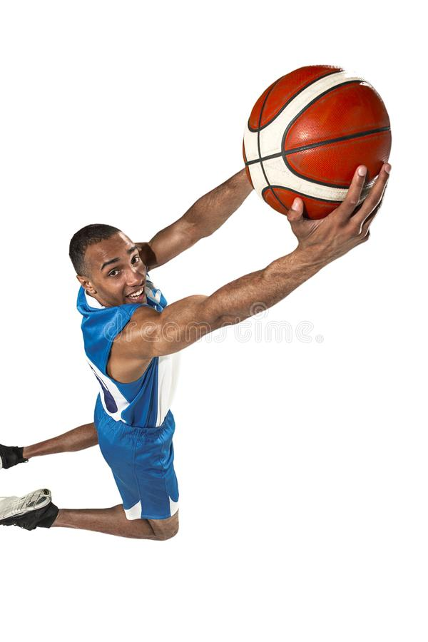 Full length portrait of a basketball player with ball. Full length portrait of a basketball player with a ball isolated on white studio background. advertising royalty free stock photo