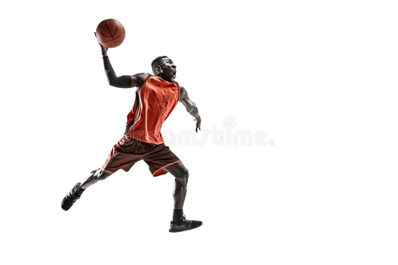 Full length portrait of a basketball player with ball. Full length portrait of a basketball player with a ball isolated on white studio background. advertising royalty free stock image