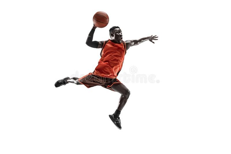 Full length portrait of a basketball player with ball. Full length portrait of a basketball player with a ball isolated on white studio background. advertising stock images