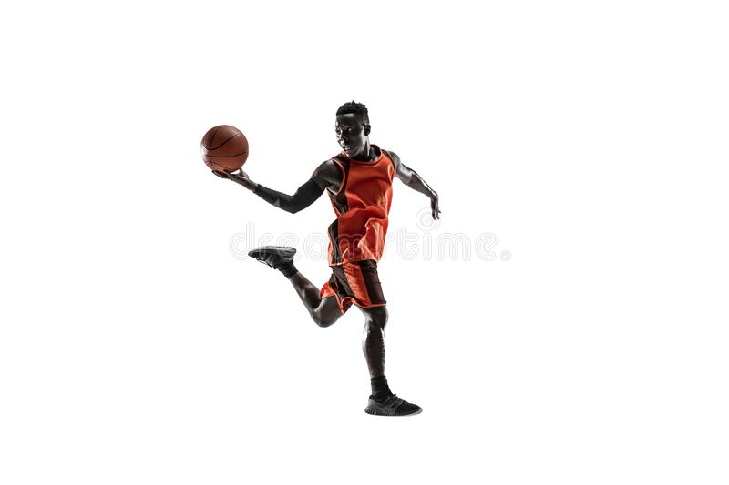 Full length portrait of a basketball player with ball. Full length portrait of a basketball player with a ball isolated on white studio background. advertising royalty free stock photos