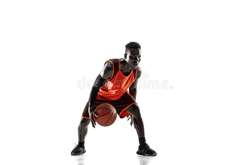 Full length portrait of a basketball player with ball. Full length portrait of a basketball player with a ball isolated on white studio background. advertising royalty free stock photography