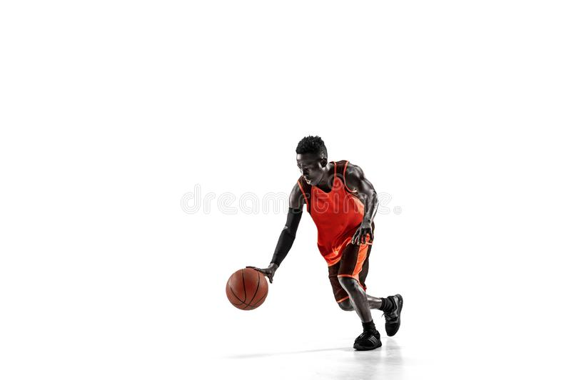 Full length portrait of a basketball player with ball. Full length portrait of a basketball player with a ball isolated on white studio background. advertising stock photo