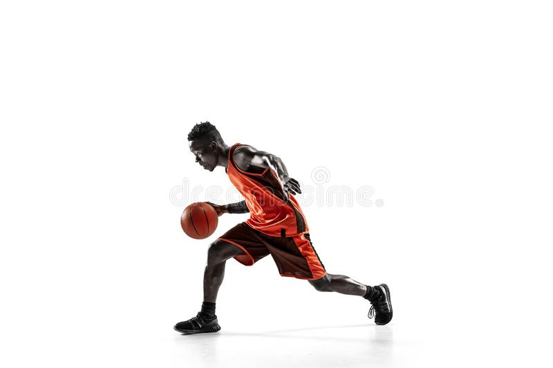 Full length portrait of a basketball player with ball. Full length portrait of a basketball player with a ball isolated on white studio background. advertising stock image
