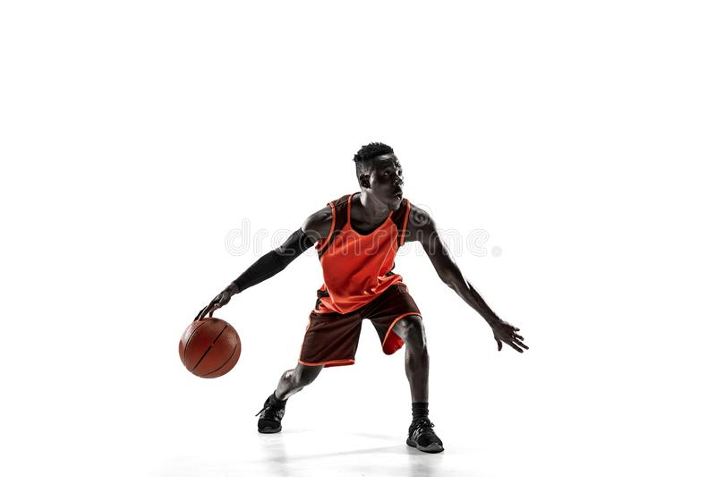 Full length portrait of a basketball player with ball. Full length portrait of a basketball player with a ball isolated on white studio background. advertising stock photography
