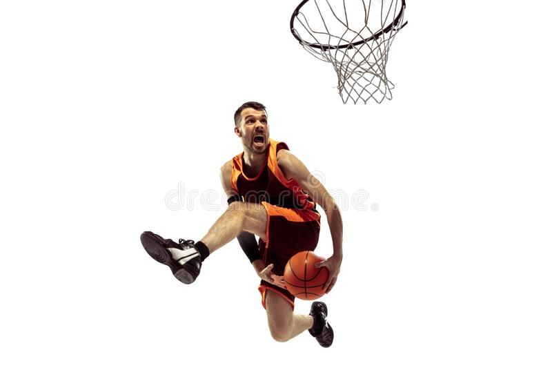 Full length portrait of a basketball player with ball. Isolated on white background. Advertising concept. Fit caucasian athlete jumping at studio. Motion stock photography