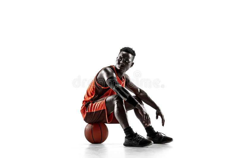 Full length portrait of a basketball player with ball. Full length portrait of a basketball player with a ball isolated on white studio background. advertising royalty free stock images