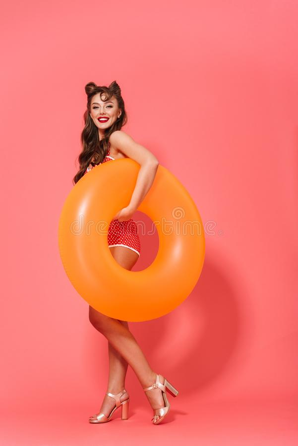 Full length portrait of a beautiful cheerful pin-up woman stock photography