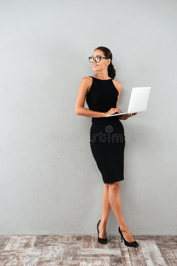 Full length portrait of a beautiful happy businesswoman royalty free stock photo