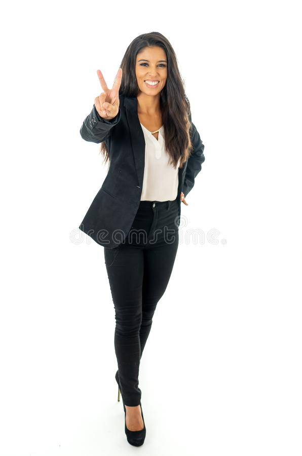 Full length portrait of a beautiful latin businesswoman smiling and making thumbs up sign standing isolated on a white background royalty free stock photos