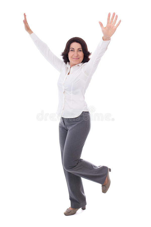 full length portrait of beautiful mature business woman celebrating something isolated on white stock photos