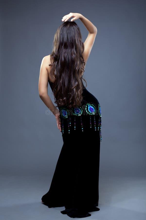 Beautiful oriental dancer with long hair stock photos