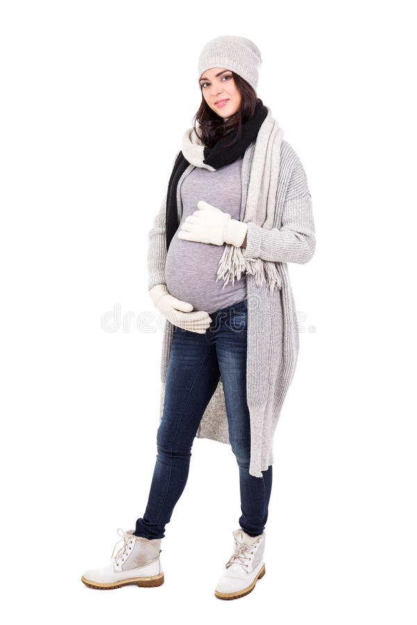 Full length portrait of beautiful pregnant woman in warm winter royalty free stock photo