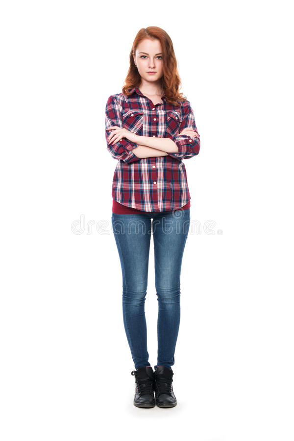 Full-length portrait of a beautiful young red-haired girl looking at the camera stock photography