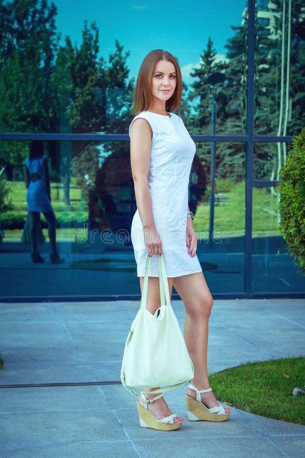 Full length portrait of beautiful young smiling woman royalty free stock image