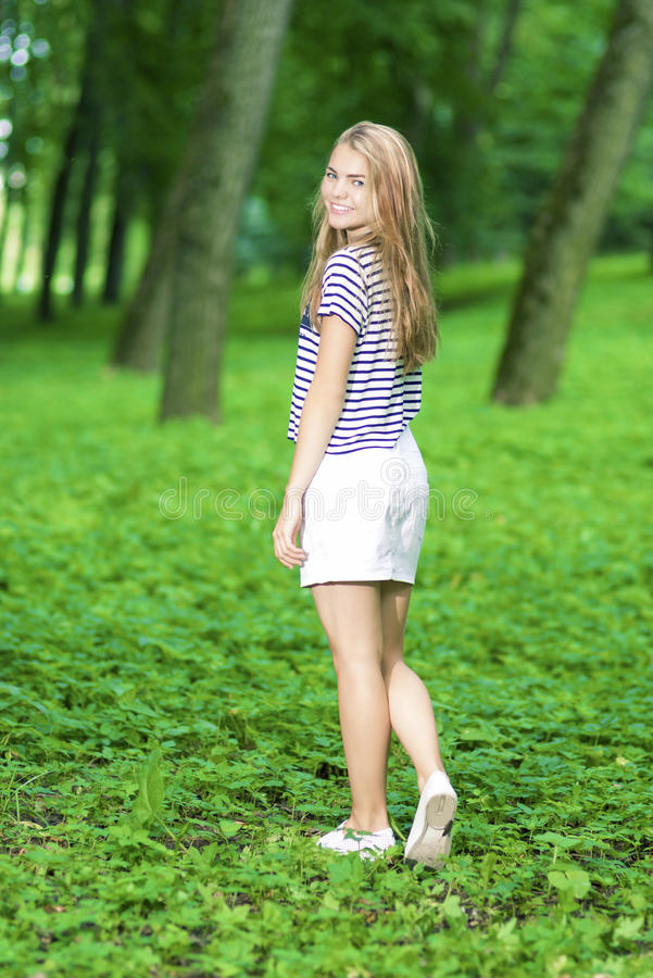 Full Length Portrait of Blond Caucasian Teenager Girl. Teenagers Lifestyle Concepts. Full Length Portrait of Blond Caucasian Teenager Girl Posing Outside in stock photos