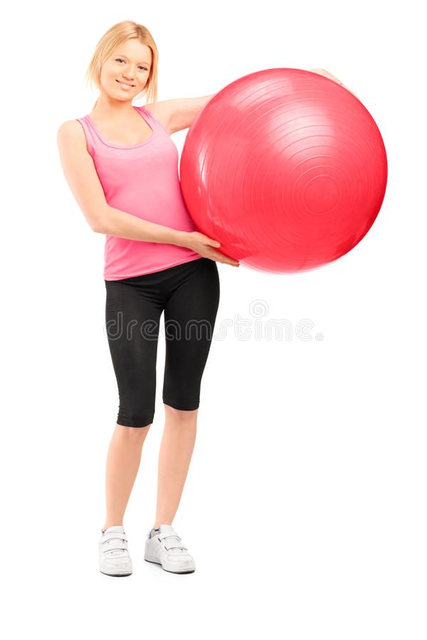 Download Full Length Portrait Of A Blond Female Athlete Holding A Pilates Stock Photo - Image: 30128206
