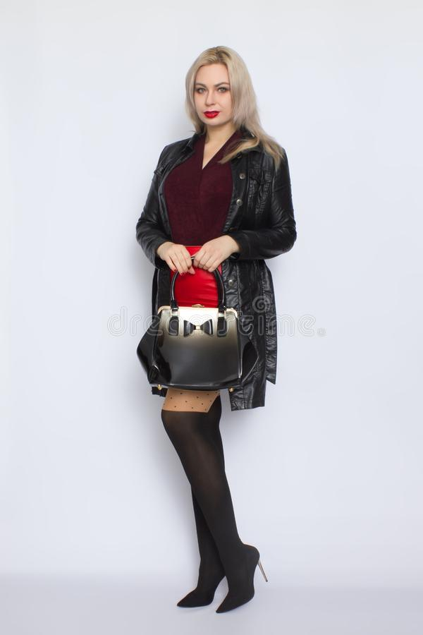 Full length blond holding bag in her hands royalty free stock images