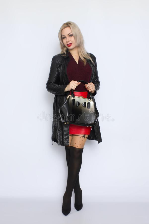 Full length blond holding bag in her hands royalty free stock photo
