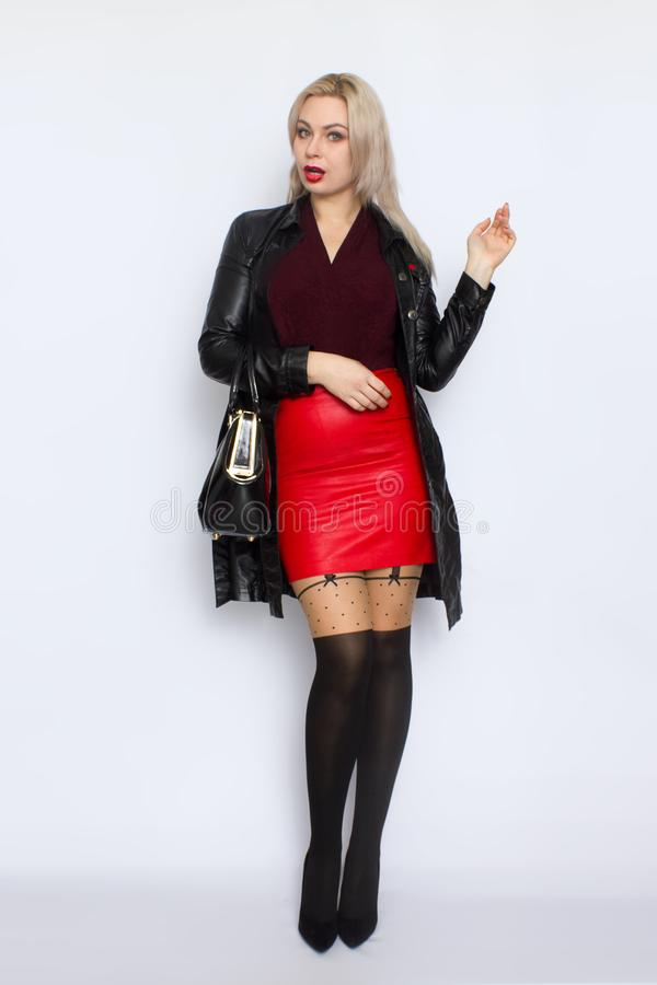 Full length blond holding bag in her hands stock photos