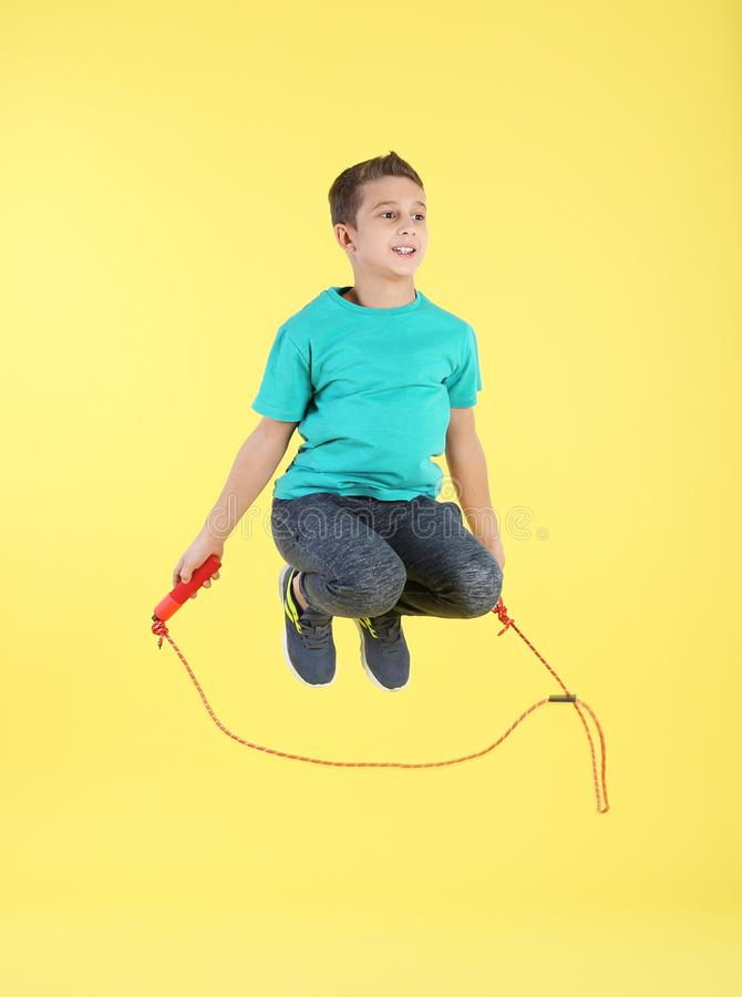 Full length portrait of boy jumping rope royalty free stock images