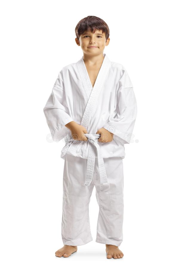 Boy in karate kimono holding his white belt royalty free stock images