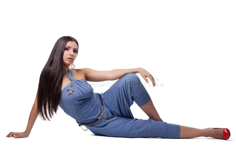 Pretty young woman in overalls royalty free stock image