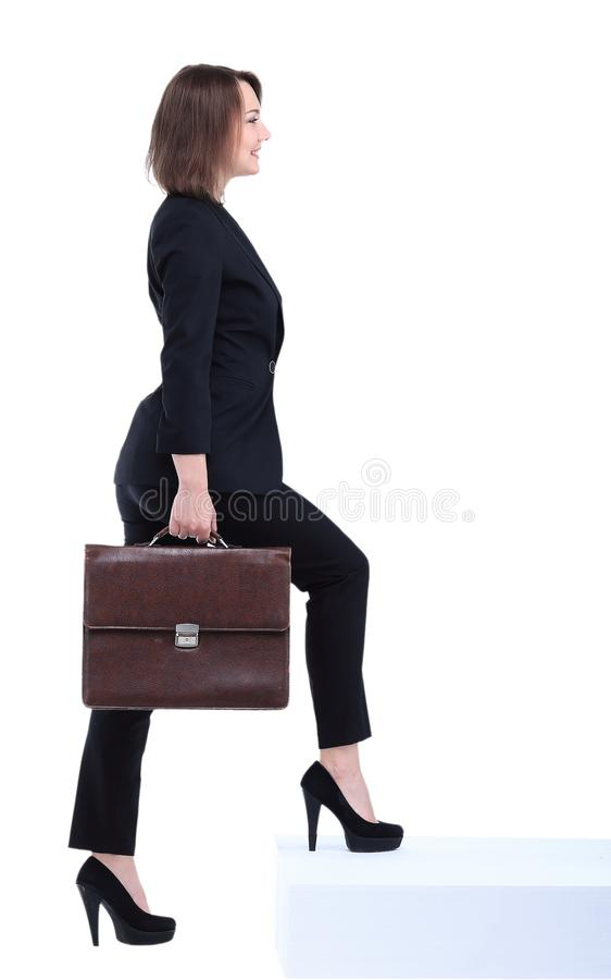 Full length portrait of business woman with briefcase going royalty free stock image