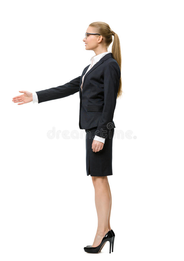 Full-length portrait of business woman handshaking stock photo