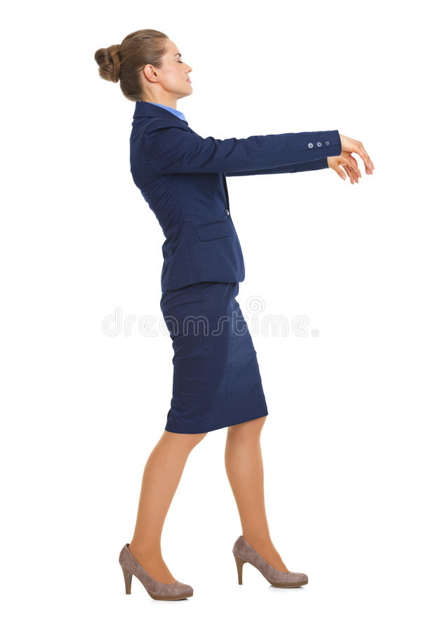 Full length portrait of business woman walking like zombie royalty free stock photography