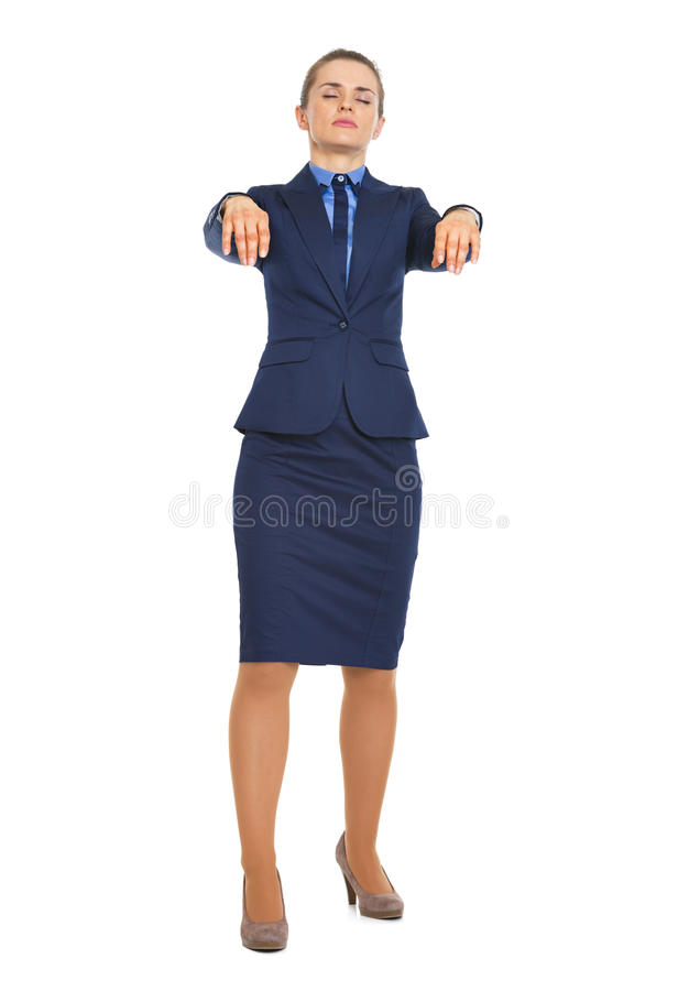 Full length portrait of business woman walking like zombie royalty free stock photos