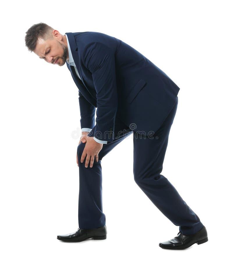 Full length portrait of businessman having knee problems. On white background royalty free stock image