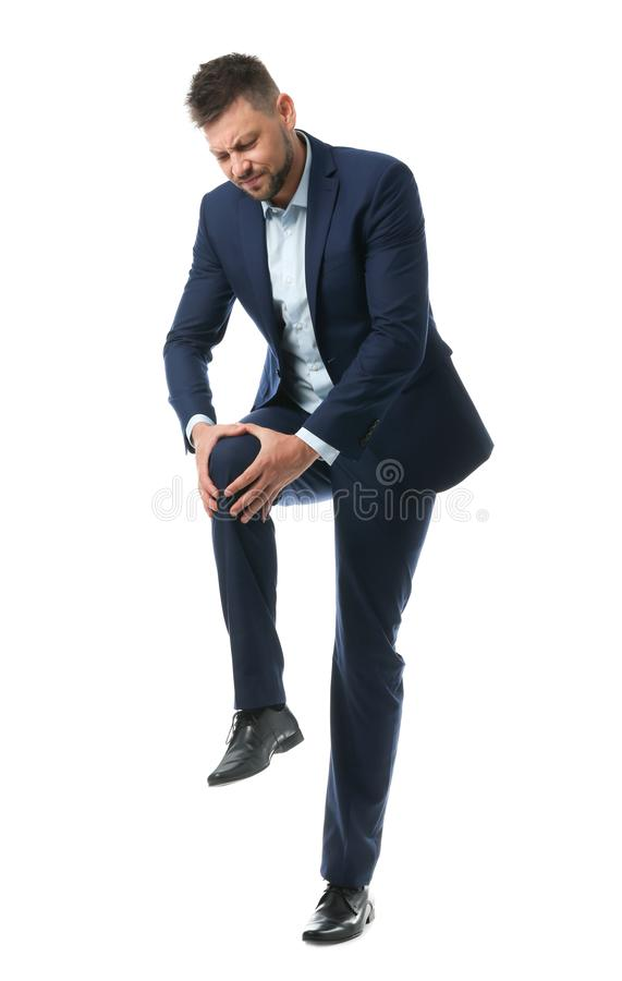 Full length portrait of businessman having knee problems on white. Background royalty free stock photos
