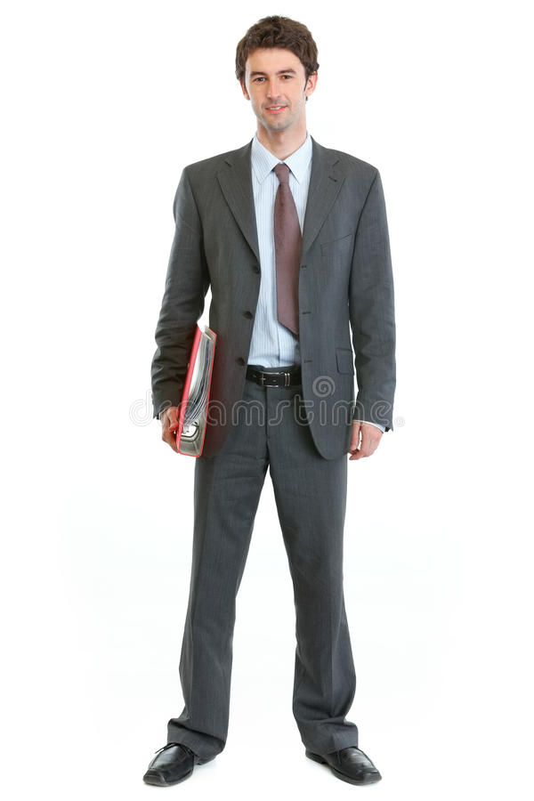 Full length portrait of businessman holding folder royalty free stock image