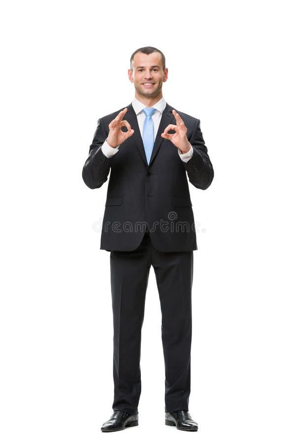 Full-length Portrait Of Businessman Ok Gesturing Stock Photography