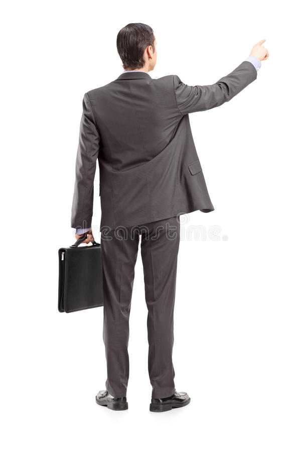 Full Length Portrait Of A Businessman Pointing In A Direction, S Royalty Free Stock Photos