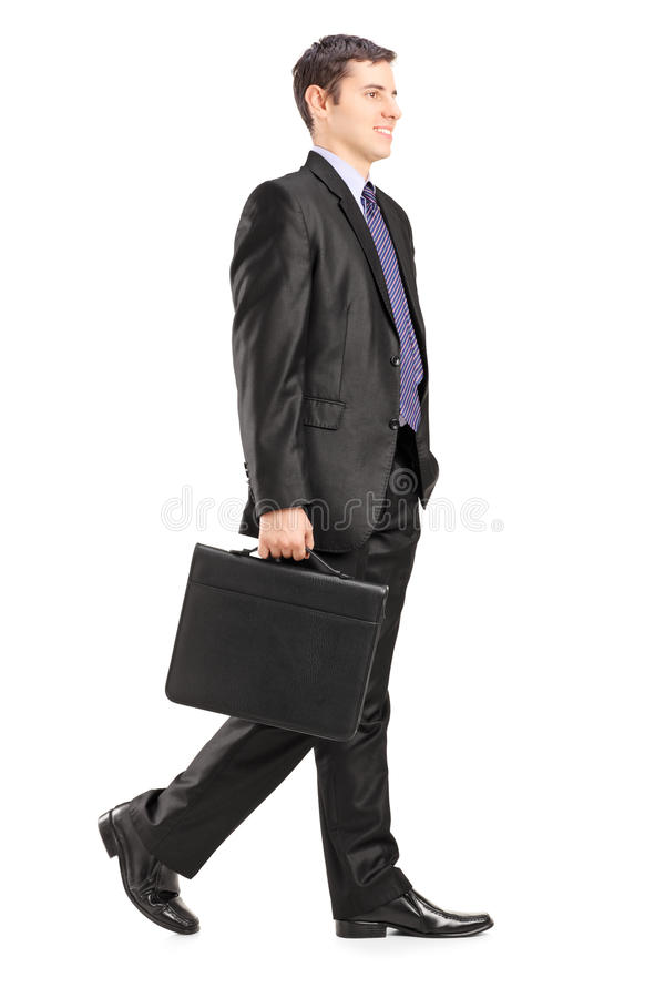 Full length portrait of a businessman walking and holding a brie royalty free stock photography