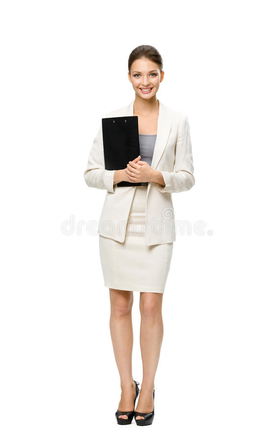 Full-length portrait of businesswoman with documents. Full-length portrait of businesswoman keeping folder, isolated on white. Concept of leadership and success stock images