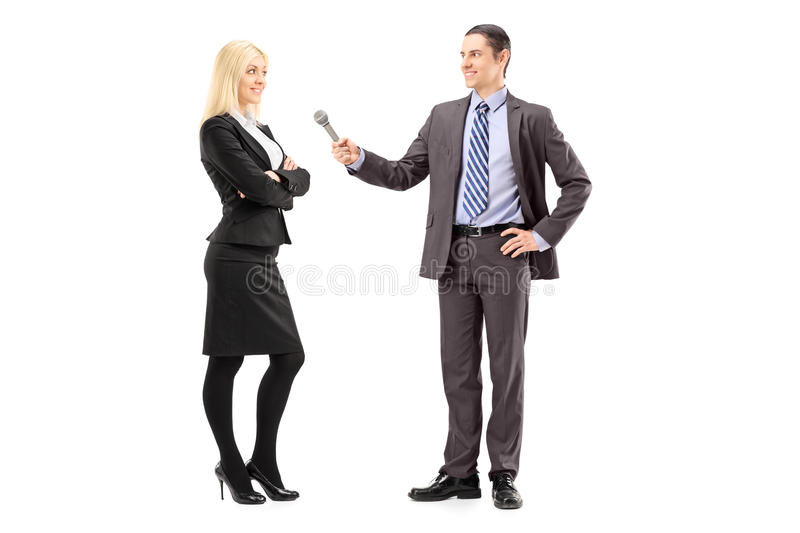 Download Full Length Portrait Of A Businesswoman And Male Reporter Having Stock Image - Image: 30128211