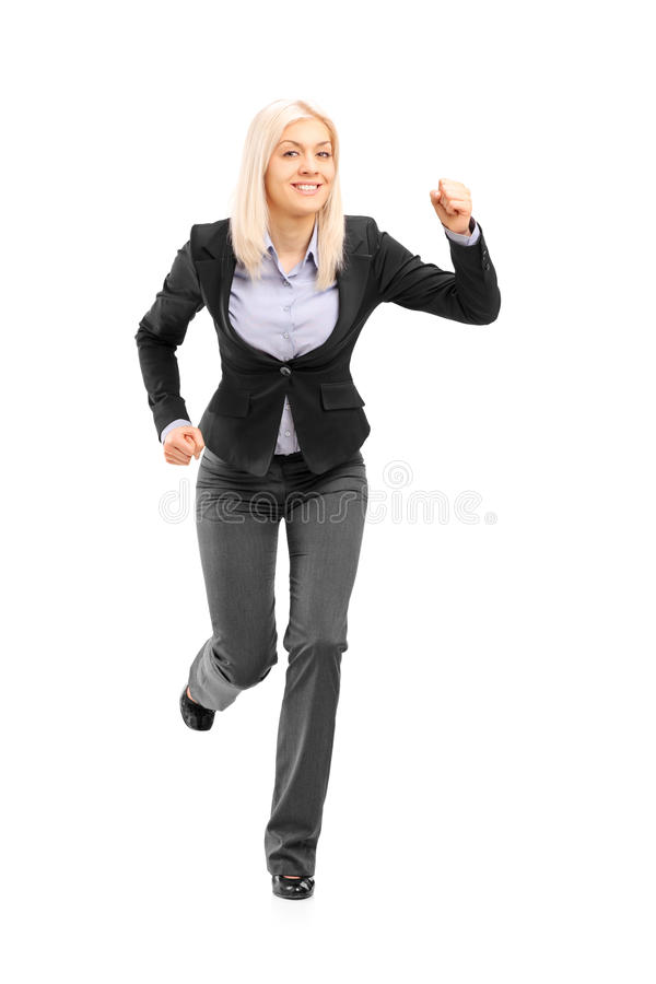Full length portrait of a businesswoman running and looking at c. Amera isolated on white background stock photography