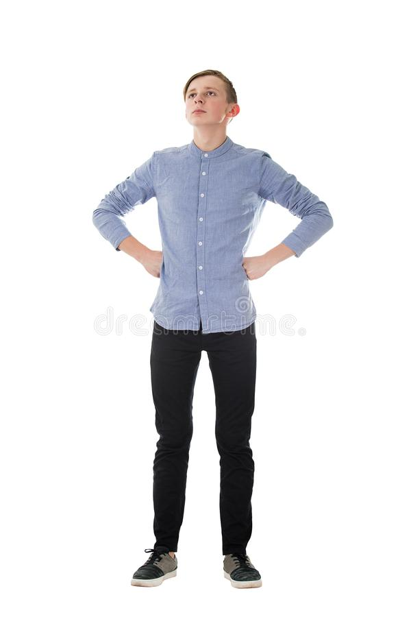 Full length portrait casual boy teenager posing hands on hips showing chest and power like a superhero isolated over white stock photos