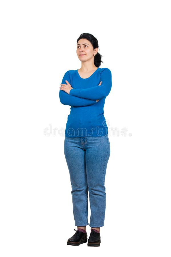 Full length portrait of casual, confident young woman posing with arms crossed isolated over white background with copy space. royalty free stock image
