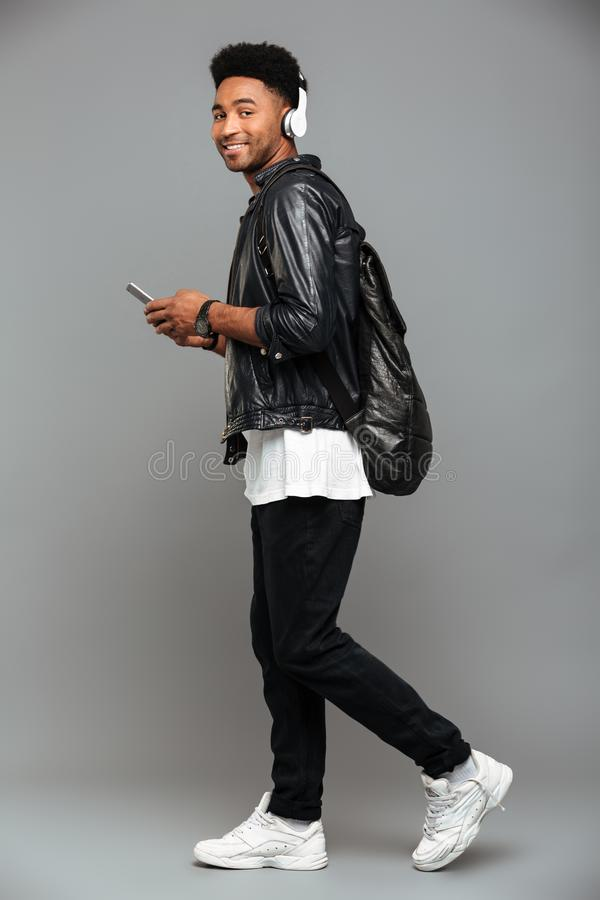 Full length portrait of a casual young afro american man royalty free stock images