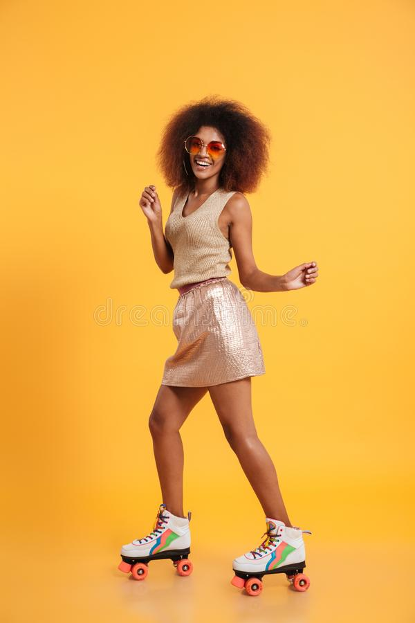 Full length portrait of a cheerful afro american woman stock photography