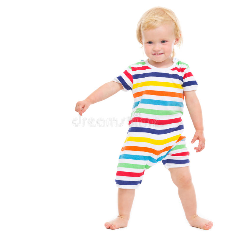 Full length portrait of cheerful baby in swimsuit. Full length portrait of cheerful baby girl in swimsuit royalty free stock photography
