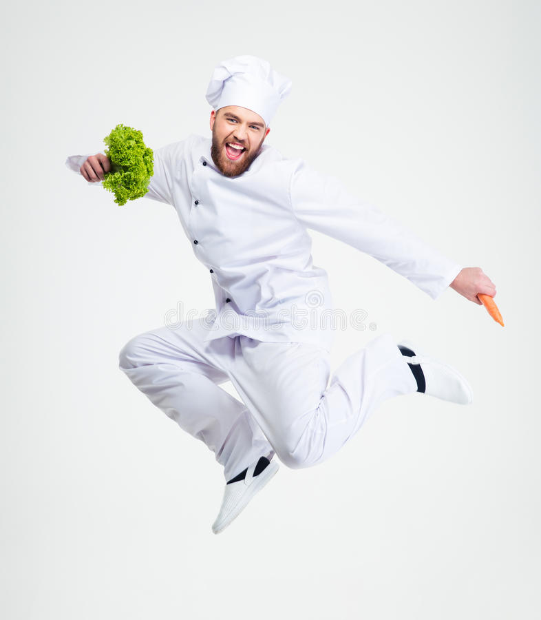 Full length portrait of a cheerful chef cook dancing stock photo