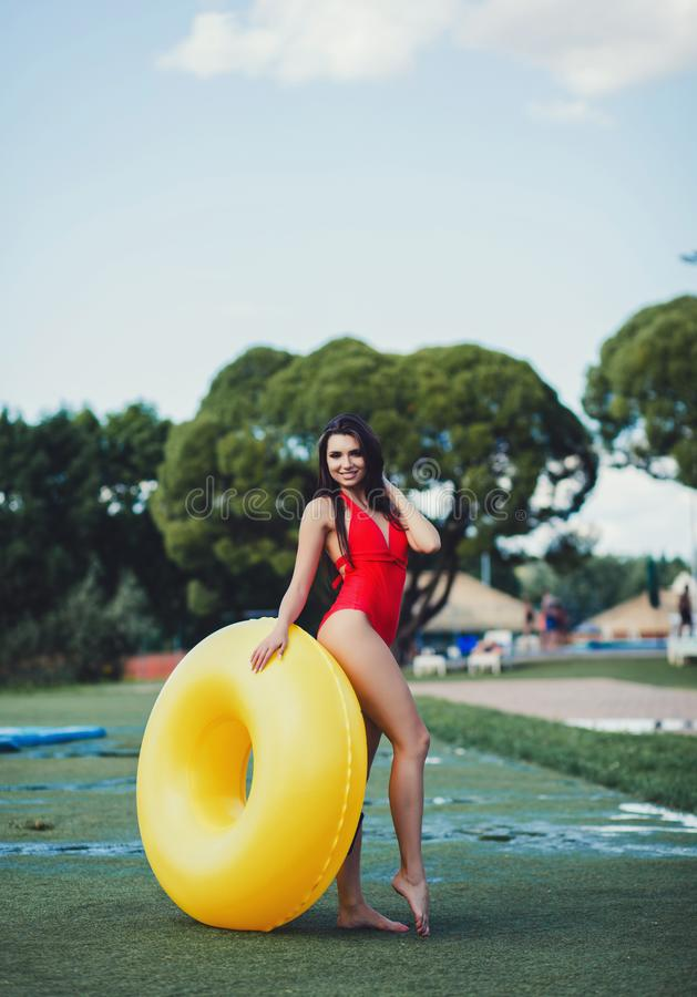Full length portrait of a cheerful girl in swimsuit stock image