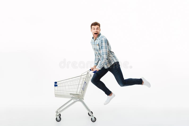 Full length portrait of a cheerful man jumping royalty free stock images